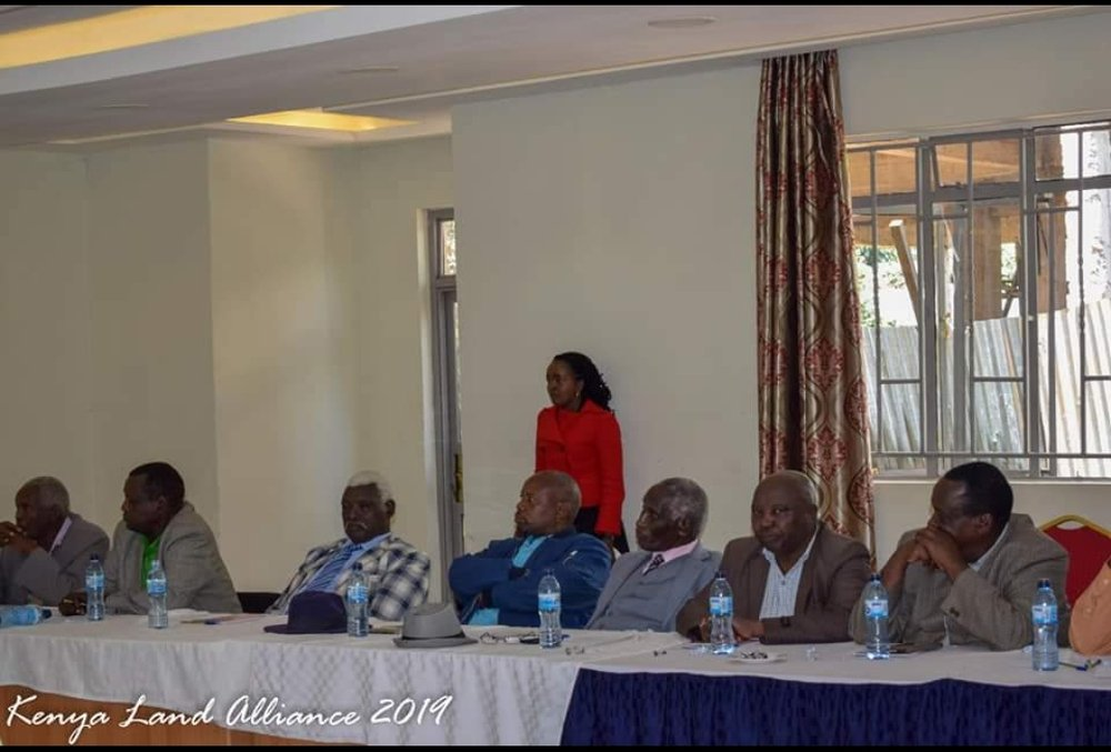 Winny conducting a roundtable on inclusion of women in the community lands in Kenya